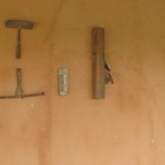 Tools used in the old days hanging on wall