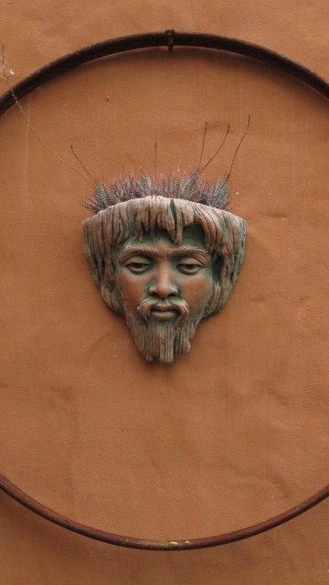 Potter Jan du Toit's stone face with plants on head