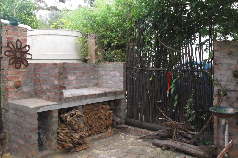 Stone braai spot with cut wood