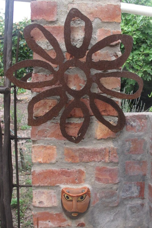 Rusting flower and ceramic face