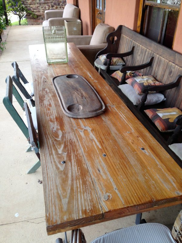 Wooden table with church bench seating